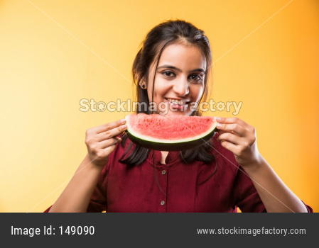 Young beautiful girl eating watermelon / tarbuj fruit