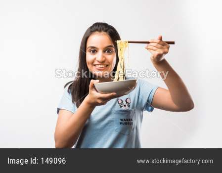 Beautiful young girl eating Chinese noodles