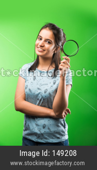 Beautiful college girl with magnifying glass