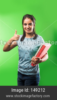 Indian/asian attractive female student with holding piggy bank and books