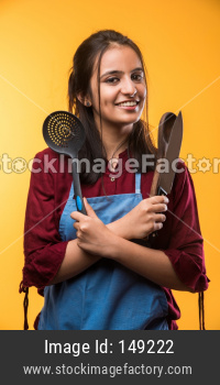 Beautiful young girl chef with spatula