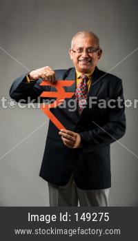 senior business man in suit standing isolated over dark background with piggy bank and money