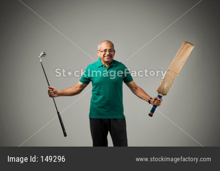 Senior indian man playing cricket with bat