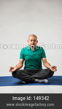 Senior indian man doing yoga or meditation