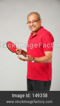 Senior indian man playing table tennis