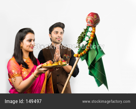 Gudi Padwa Celebration - Indian smart couple performing puja on Hindu New year , isolated over white background