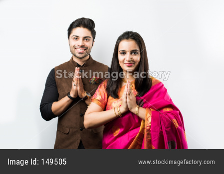 Portrait of young couple in traditional cloths, isolated over white background