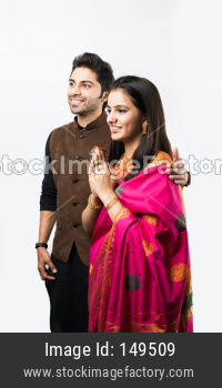 Indian couple in ethnic wear in namaskara pose or greeting