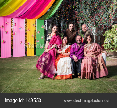 Group photo of indian family while celebrating festival