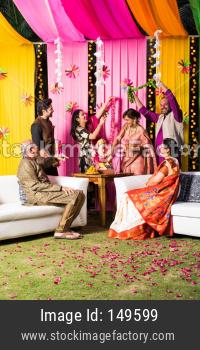 Indian family celebrating Ganesh festival with Ganesha Idol