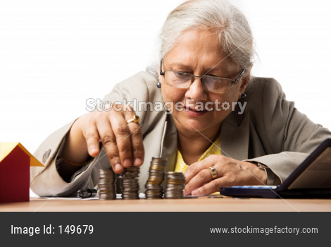 Senior woman with money/coins - saving concept