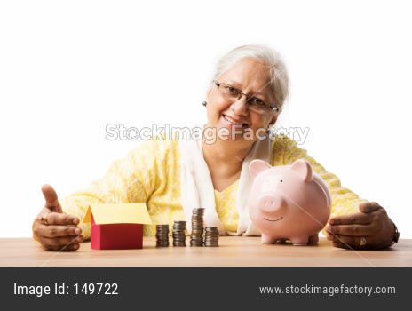 Senior woman with money or coins and piggy bank- saving concept