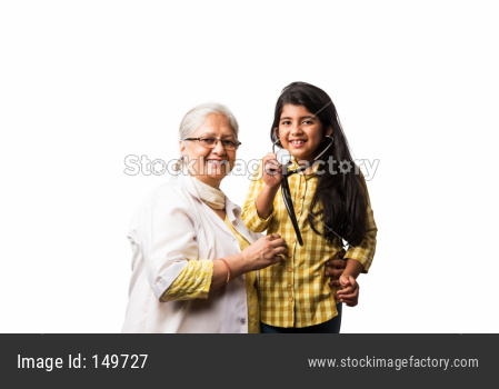 Senior Female Doctor and small girl patient with stethoscope