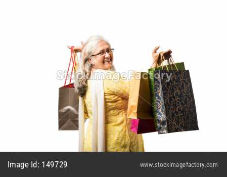 Senior woman and grand daughter - real estate concept with money