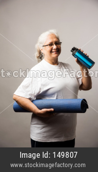 Senior Indian/asian lady exercising - Women Fitness and age concept