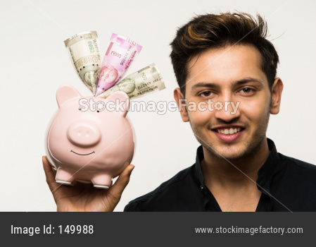 College boy holding piggy bank