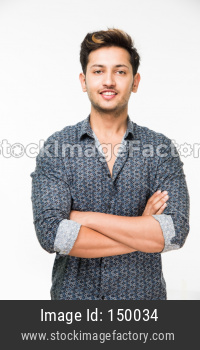 portrait of cheerful Indian young man/boy, standing isolated over white background