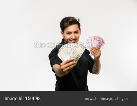 Young man holding cash / money fan / dollars