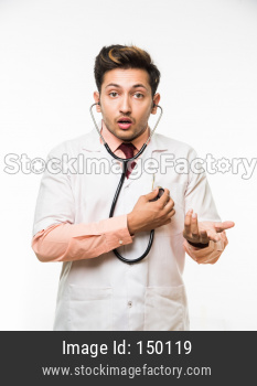 Young male doctor / nurse with stethoscope, standing isolated over white background