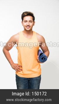 Young man with yoga mat
