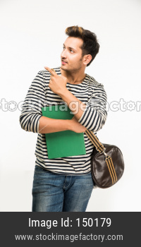 Young male college student standing with bag and books/laptop computer, isolated over white background