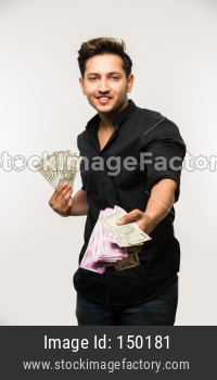Young man holding cash / money fan / dollars