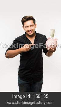 College boy holding piggy bank