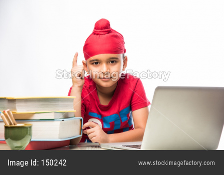 cute little sikh/punjabi boy and girl standing isolated over white background, facing camera
