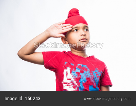 Portrait of Indian Sikh/punjabi little boy standing isolated over white background