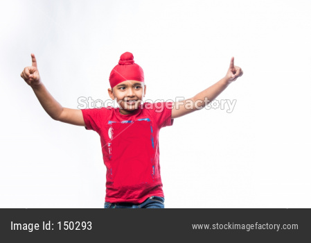 Portrait of Indian Sikh/punjabi little boy dancing/doing bhangra over white background