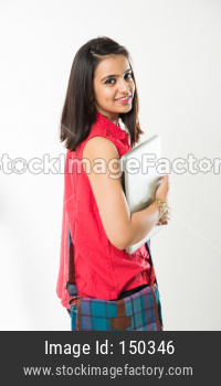 Pretty Indian/Asian young college Girl holding Laptop Computer, Standing isolated against white background