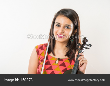 Pretty Indian/Asian young Girl musician playing Violin against white background
