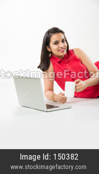 College girl sitting with laptop and books over white background