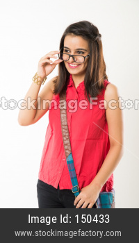 Pretty Indian/Asian College Girl holding books and bag while standing isolated over white background