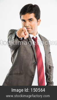Indian young businessman pointing