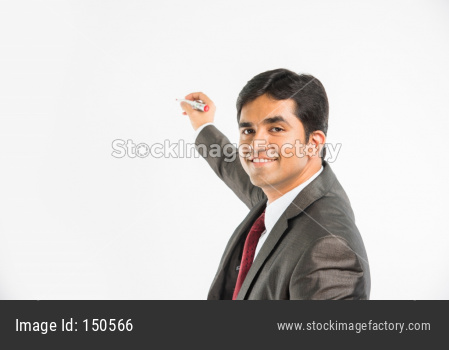 Indian young businessman writing with marker pen on blank/empty space