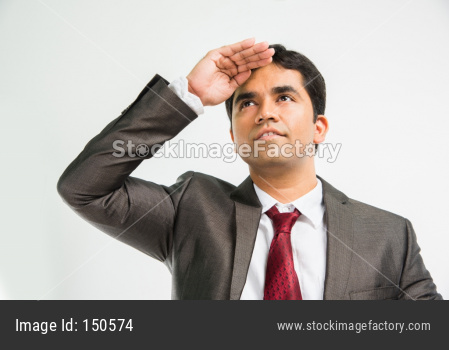 Indian young businessman looking far with hand gesture