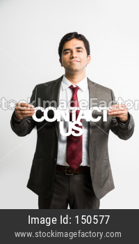 Indian young businessman holding contact us cutout