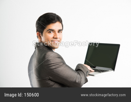 Indian young businessman with laptop computer