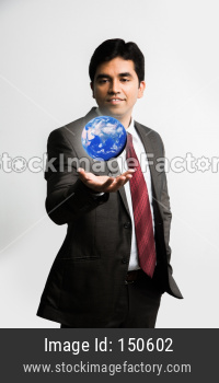 Indian young businessman with 3d model of globe