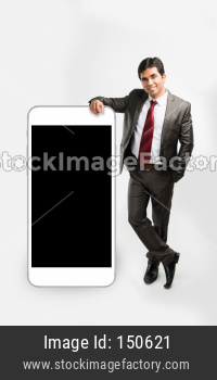 Indian young businessman with dummy big size smartphone