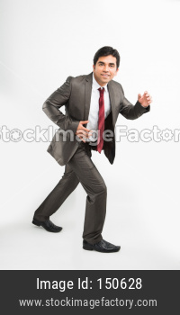 Indian young businessman running / sprinting