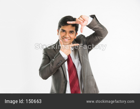 Indian young businessman composing picture frame
