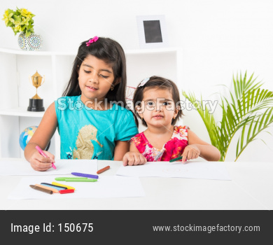 Little girl playing with colourful toys