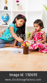 cute Little girl/sisters colouring with coloured pen/pencil