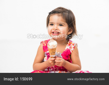 cute little girl eating Ice cream in cone