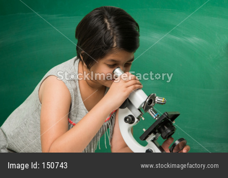 Cute little school girl studying science