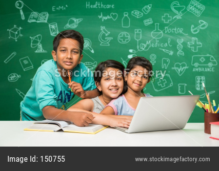 small boy and girls studying science in classroom against green chalkboard background with science doodles
