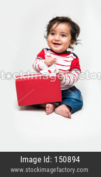 Indian cute little baby /infant or toddler smiling with gift box over white background