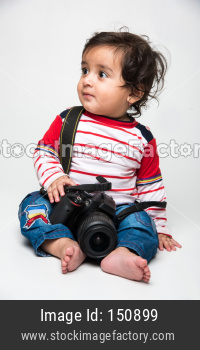 cute little Indian baby boy photographer holding DSLR camera
